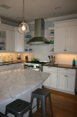 Seattle kitchen update, Traditional white kitchen with vintage and industrial elements., Honed cararra marble on the island and gray quartz counters on the perimeter soften the kitchen and replace the previous black polished granite.   , Kitchens     Design