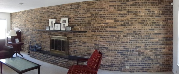 Advice: Horrible Brick Wall, This wall is horrible.....27 Feet of late 60's brown and black brick.  I'm looking to get your thoughts, what would you do to it?  I don't really want to remove it completely.  I plan to remodel the entire room, so ignore the furniture, etc.    Give me your thoughts?, Living Rooms Design