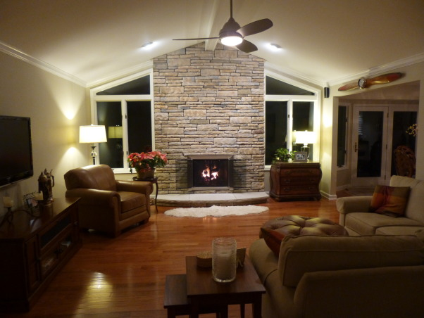 Fireplace Remodel, Stone Fireplace and New Hardwood Floors were added to update 1980's fireplace, After - New Stone was added over existing brick. New limestone hearth and New Hardwood floors.   , Living Rooms Design