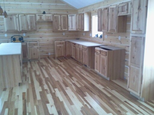 Building our new home, This is a picture of our kitchen as we are trying to finish it. We're building our home and it's just about done.  Regular house out, log cabin in.  , Kitchen flooring finally done.  Wow are we tired and sore, LOL. , Other Spaces Design