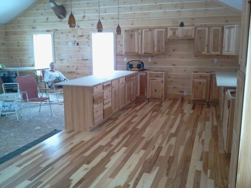 Building our new home, This is a picture of our kitchen as we are trying to finish it. We're building our home and it's just about done.  Regular house out, log cabin in.  , Other Spaces Design