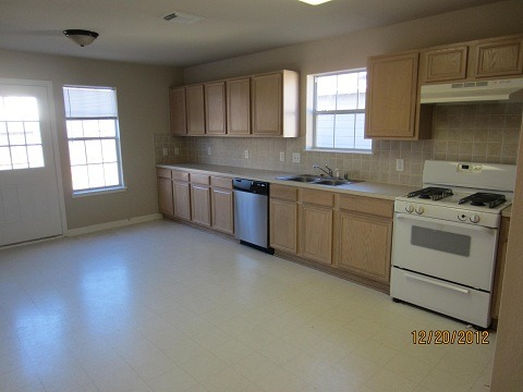 "Help - Long rectangular Kitchen NEEDs updated :/, Need help with long boxy ""eat in"" Kitchen for a rental property. On a tight budget here so new appliances are out. Thinking about cabinet hardware, maybe hanging light, Any other ideas? should table go in center or at end by door, eek!, Long rectangular ""eat-in"" kitchen needs some budget friendly updates. cabinet hardware, maybe hanging light, where does table go? a long blank wall is opposite. Any ideas? Help!, Kitchens Design"