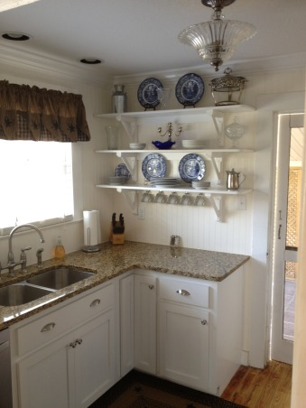 Small cottage delight, Small bright space with open shelving, beadboard, and stainless appliances., Love the shelves!, Kitchens Design