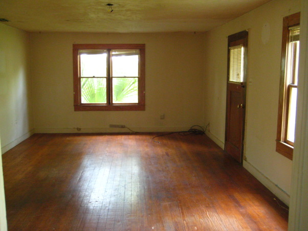"Colorful Cottage Living, With warm refinished antique heart pine floors and a ""pop"" of color, this room is warm and cozy., Before.  Yuck!, Living Rooms Design"