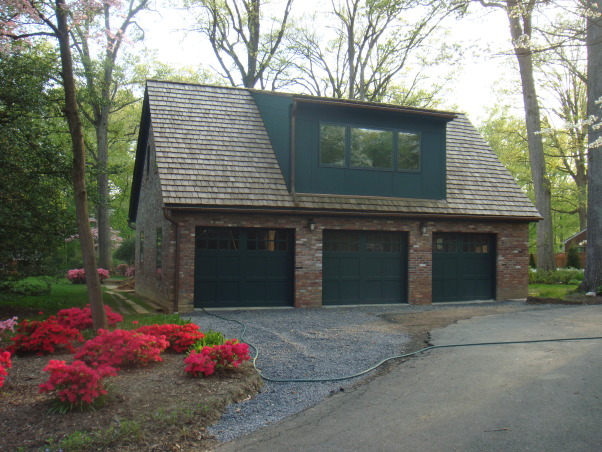 Three level split remodel, Home started as 1700 sq. ft. three level split.   3 bedrooms, 1 & 1/2 bath, living room, kitchen/dining room, basement, one car garage and screen porch.   Finished area is 6400 sq. ft. with 5 bedrooms, 4 & 1/2 baths, sunroom, library, mudroom, upstairs utility room, studio, foyer, basement and walk-out patio.  Not included in the 6400 sq. ft is a three car garage (24' x36') and fully acessable and conditioned attic(45' x @15')  I designed and built the structure myself (my first project).  Design and built in 5 phases over 2 year period.   I did have a mason do the brick work, all other work completed by me.  Still working on the house.  , Closer view of the garage.  Went with single doors to insure cars would fit easily.      , Home Exterior Design