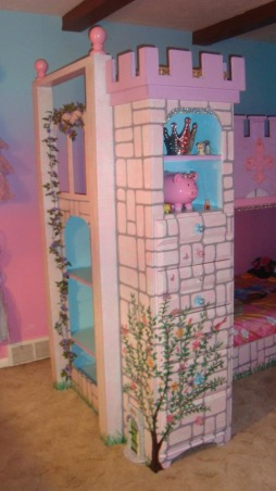 Princess room for three, We lost our son and daughter in law in Oct. 2012 and found we would be sharing in the raising of our three grand-daughters. We wanted them to feel overwhelming love and have a magical place to just be little girls and let their imagination run free. The castle was born! We created this room with mostly recycled furniture and some wood and about 5 gallons of paint. We think it came out beautiful. Three tone walls, custom bed, and darling chandelier, make this room a magical spot in our home. , Princess tower with two display shelfs and a hidden dresser.       , Girls' Rooms Design