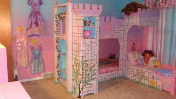 Princess room for three, We lost our son and daughter in law in Oct. 2012 and found we would be sharing in the raising of our three grand-daughters. We wanted them to feel overwhelming love and have a magical place to just be little girls and let their imagination run free. The castle was born! We created this room with mostly recycled furniture and some wood and about 5 gallons of paint. We think it came out beautiful. Three tone walls, custom bed, and darling chandelier, make this room a magical spot in our home. , Princess room for three little princesses.           , Girls' Rooms Design