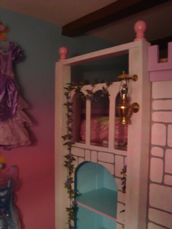 Princess room for three, We lost our son and daughter in law in Oct. 2012 and found we would be sharing in the raising of our three grand-daughters. We wanted them to feel overwhelming love and have a magical place to just be little girls and let their imagination run free. The castle was born! We created this room with mostly recycled furniture and some wood and about 5 gallons of paint. We think it came out beautiful. Three tone walls, custom bed, and darling chandelier, make this room a magical spot in our home. , Balcony with flower vines ;o) , Girls' Rooms Design