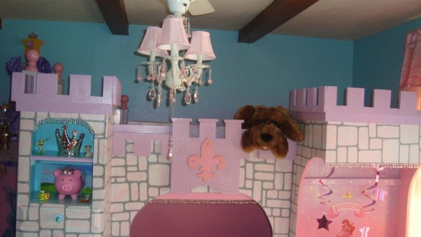 Princess room for three, We lost our son and daughter in law in Oct. 2012 and found we would be sharing in the raising of our three grand-daughters. We wanted them to feel overwhelming love and have a magical place to just be little girls and let their imagination run free. The castle was born! We created this room with mostly recycled furniture and some wood and about 5 gallons of paint. We think it came out beautiful. Three tone walls, custom bed, and darling chandelier, make this room a magical spot in our home. , Tops of castle and chandelier.        , Girls' Rooms Design
