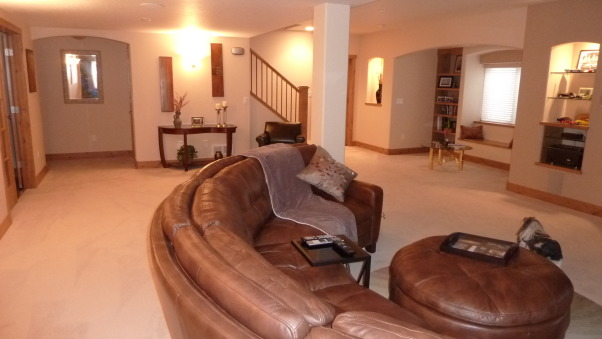 Fab Finished basement 2010, We finished our basement of our home, adding a bedroom, workout room, bath, curved bar and great tv viewing area!, That comfy curved leather sofa  , Basements Design