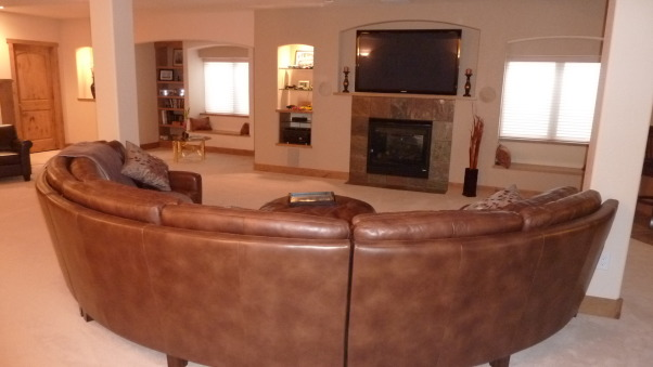 Fab Finished basement 2010, We finished our basement of our home, adding a bedroom, workout room, bath, curved bar and great tv viewing area!, Tv viewing area with curved, ever so comfy sofa  , Basements Design