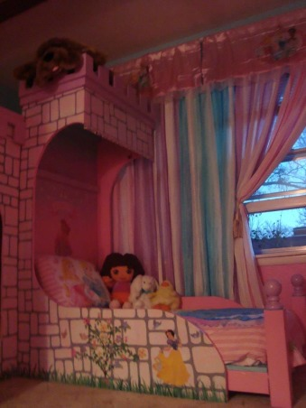 Princess room for three, We lost our son and daughter in law in Oct. 2012 and found we would be sharing in the raising of our three grand-daughters. We wanted them to feel overwhelming love and have a magical place to just be little girls and let their imagination run free. The castle was born! We created this room with mostly recycled furniture and some wood and about 5 gallons of paint. We think it came out beautiful. Three tone walls, custom bed, and darling chandelier, make this room a magical spot in our home. , Bed three for my youngest princess , Girls' Rooms Design