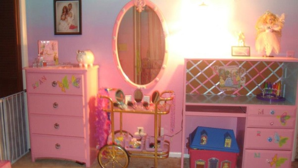 Princess room for three, We lost our son and daughter in law in Oct. 2012 and found we would be sharing in the raising of our three grand-daughters. We wanted them to feel overwhelming love and have a magical place to just be little girls and let their imagination run free. The castle was born! We created this room with mostly recycled furniture and some wood and about 5 gallons of paint. We think it came out beautiful. Three tone walls, custom bed, and darling chandelier, make this room a magical spot in our home. , North wall, desk, dresser, and dress up cart. , Girls' Rooms Design