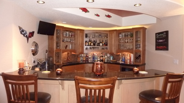 Fab Finished basement 2010, We finished our basement of our home, adding a bedroom, workout room, bath, curved bar and great tv viewing area!, Delightful curved bar  , Basements Design