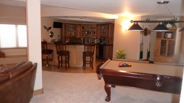 Fab Finished basement 2010, We finished our basement of our home, adding a bedroom, workout room, bath, curved bar and great tv viewing area!, Pool table, bar area  , Basements Design
