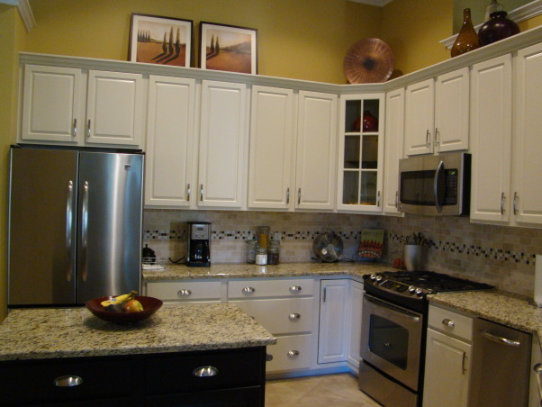 Kitchen remodel, Kitchen remodel for $16k. Painted raised panel maple cabinets. Granite counters, stainless appliances, mosaic tile backsplash and porcelin tiled floors. , Kitchens Design