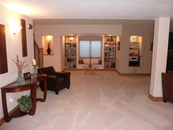 Fab Finished basement 2010, We finished our basement of our home, adding a bedroom, workout room, bath, curved bar and great tv viewing area!, view from workout room, Basements Design