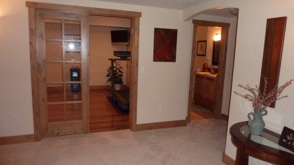Fab Finished basement 2010, We finished our basement of our home, adding a bedroom, workout room, bath, curved bar and great tv viewing area!, Looking into the workout room and the bath to the right , Basements Design