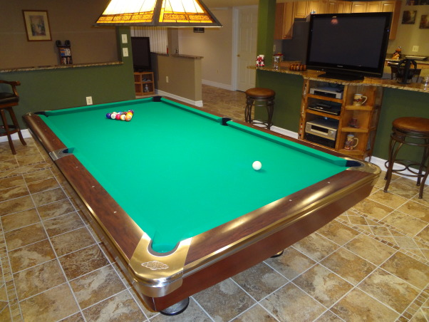 The Pool Room, 2250 square foot basement including storage and living space. I did't have a huge budget so I had to do the work myself. I wanted something practical that functioned well for my wife and myself. The entire job cost less than 38,000.00. That includes everything you see except the furniture and pool table, even the drywall and insulation is included. I look to books and the internet for inspiration sometimes but it's hard to find something practical that the average person can use in their own home. I would like to see more home designs that the working class man can aford and the use of materials that are widely available. , Basements  Design