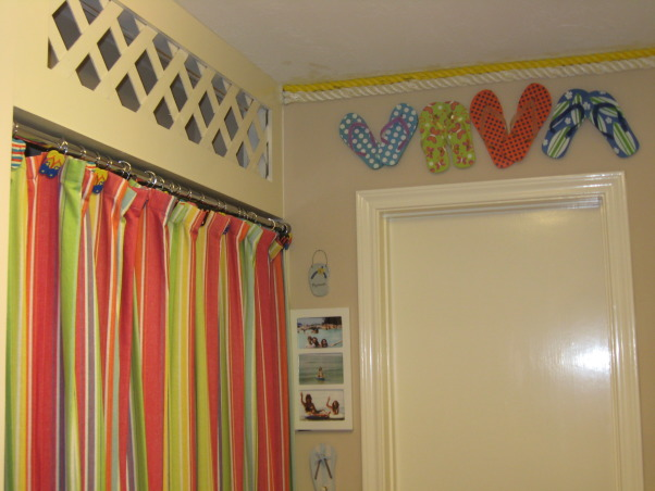 "Laundry Room , Flip Flops At The Beach, Flip flops above the door and on the curtain because this is our beach room!  I used 2 shower curtains to cover up the ironing board & clothes hanging area & I have found ""flip flops"" from vacations we have been on to place around the room.        , Other Spaces        Design"