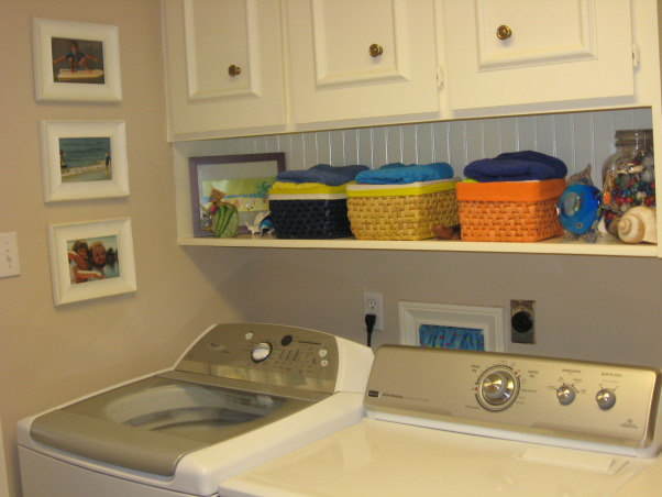 Laundry Room , Flip Flops At The Beach, There are colorful glass fish next to baskets above the washer and dryer. I made a curtain for the washer/dryer hook up window.        , Other Spaces        Design