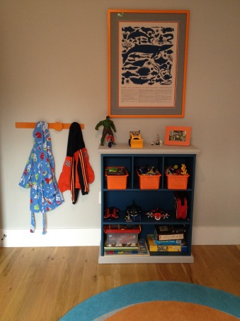 happy room for a 4 year old boy, this room came together based off of the shark bedding from pottery barn kids.  my then 3 year old liked it and i happened to like it too, so there you go.  he asked for the orange wall, which i also was on board with.  i've found so many options when searching for sea life accessaries.  it's been fun!, framed art - land of nod hanging hooks - land of nod (old!) bookshelf - painted from target bins - target dollar section  , Boys' Rooms   Design