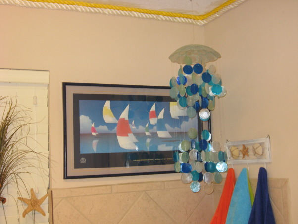 Laundry Room , Flip Flops At The Beach, Laundry room corner, complete with sail boat art, and capiz shell ornament.  I believe the laundry room, where we spend a lot of time, should be a fun place!       , Other Spaces        Design