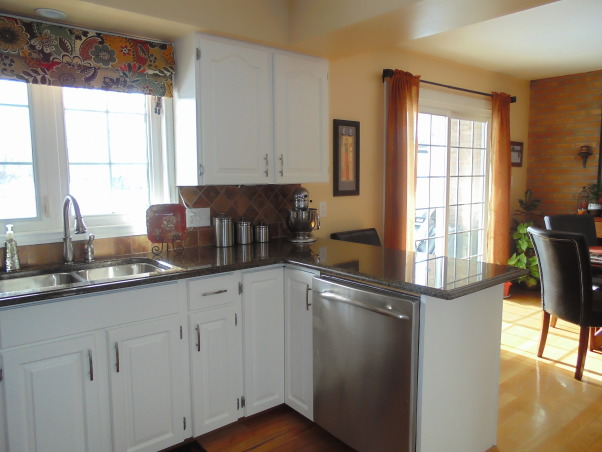 From dark oak to bright, clean, off white, After 17 years we were growing tired of our oak kitchen cabinets.  They were still in great condition so we decided to paint them.  We can't believe the difference., What a difference some paint makes , Kitchens Design