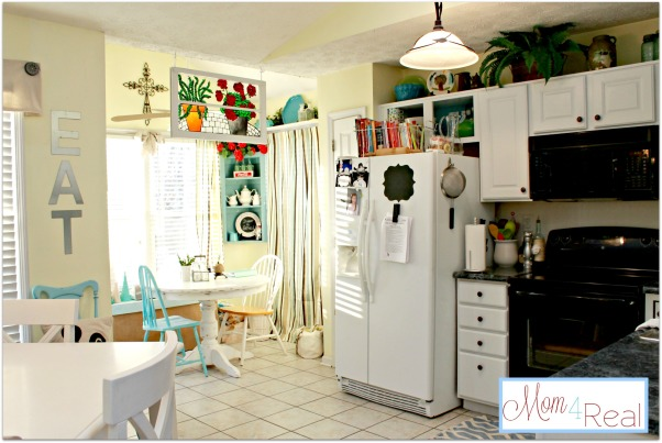 Open Colorful Kitchen Cabinets, Kitchen cabinets with doors removed for open shelving.  Added a splash of aqua and some silver, white, lime green, and turquoise accents along with a chalkboard menu., View of the breakfast nook and open cabinet over the refrigerator., Kitchens Design