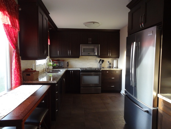 A bit disappointed!, A new space with cuisines laurier maple cabinets in a Marshlands stain.  In general I like the new space but I am disappointed in the obvious stain variances. I have been told it is an acceptable variance.  Just wanted others opinions. , Kitchens Design