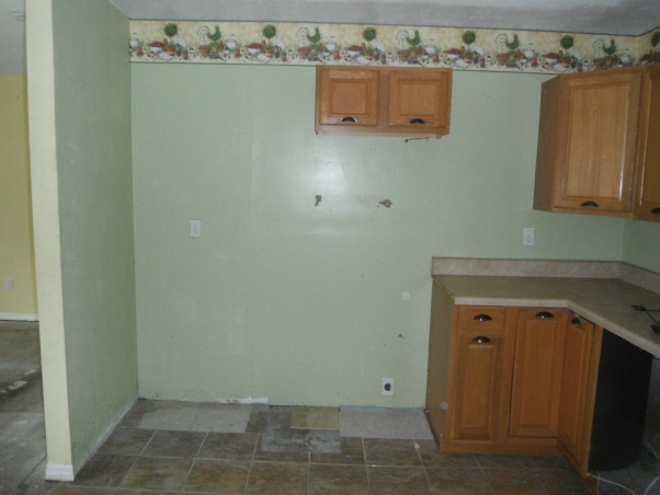 Our short sale Kitchen makeover, Short sale kitchen was short on cabinets,appliances,countertops,you name it!, Before...bad paint color and wallpaper border, Kitchens Design