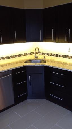 White to Mocha transformation, Glass tile backsplash (2 x 12 glass tiles) Colonial Gold Granite countertop  , Kitchens Design