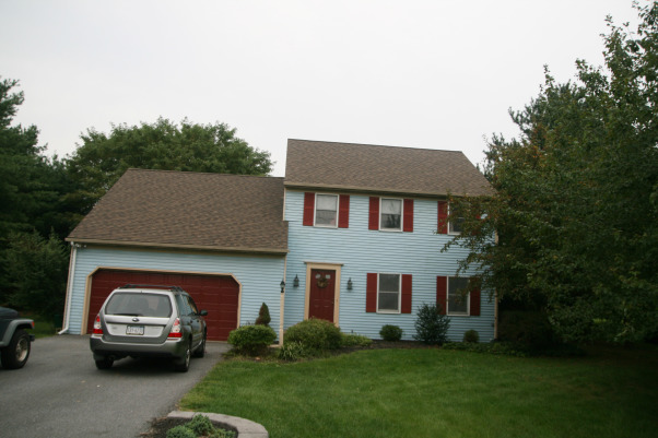 Thank goodness for paint!, We moved into this house about 6 months ago and knew that changing the exterior was one of our top priorities.  We opted to paint the vinyl rather than replacing it since it was in decent shape and painting is a big cost saver.  We used Sherwin Williams exterior paint.  We also removed the screen door, painted the front door a happy teal and replaced the shutters with new white ones.  Our next project (when the weather warms up) is refreshing the landscaping!, Yikes, it was hard to convince ourselves this aqua and fire engine red house was the right one for us! , Home Exterior Design