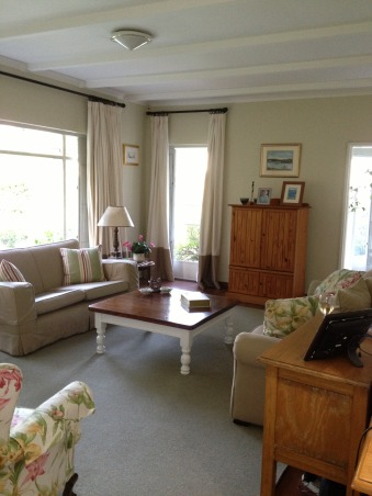 """Family living, I hope I have created a welcoming space.  I wanted my children to feel comfortable there, but I also wanted to feel that it looked """"dressed"""".  For me, it is a calm space that I can update and change easily with new pillows, and perhaps by recovering the wing backs and changing the carpet.  It is neutral but not boring., Feels so much more airy now, Living Rooms Design"""