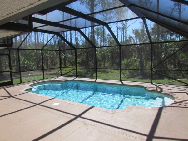 "Our little part of paradise , My wife and I purchased a recently built home in the Naples Florida area known as Golden Gate Estates. We only had one serious issue with the home. The pool area was too small to have our hot tub installed within the caged in pool area. Our only solution was to demo the brand new cage for the pool area and expand the pool deck and re-install a larger and taller pool cage. We started out with a pool area that was 25 feet by 35 feet and when we finished we have now a caged in pool area measuring 40 feet by 45 feet. The cement work, having a tiki hut 10 feet by 12 feet built and the pool cage were the only contracted work I hired out. Between myself and my brother in law we installed an outdoor kitchen and bar in the tiki hut, my brother in law built a 2 tier waterfall for the pool, installed all the landscape lighting, installed rope lighting completely around the pool area and the tiki hut and bar, and planted all the landscaping, Here was our pool area on the day we bought our new home. It was very small, very bland, and very much in need of expansion, tropical plants, and color. The whole area was laying on its back doing a scene from ""The Fly"" ""Help meeeeeeeeeee!"" One redeeming quality of our pool area is that it has a full bath within the pool area. , Patios & Decks Design"