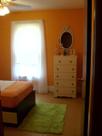 "My orange bedroom, One of three bedrooms but I painted this one orange and have more ""earth"" accents, When you first walk down the hallway and face the bedroom -colors are orange and white with electric green as an accent, Bedrooms Design"