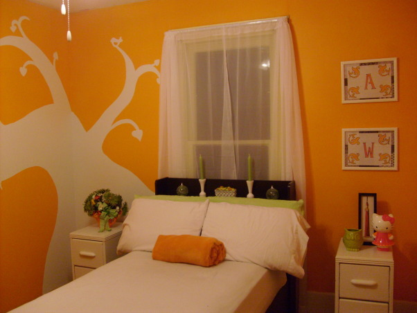"My orange bedroom, One of three bedrooms but I painted this one orange and have more ""earth"" accents, This is the left wall I put my bed on. I painted picture frames white gloss, used printer paper to make 'art' then put scrapbook paper cut into squares around the printer paper to fill space. and start of tree is on this wall, Bedrooms Design"