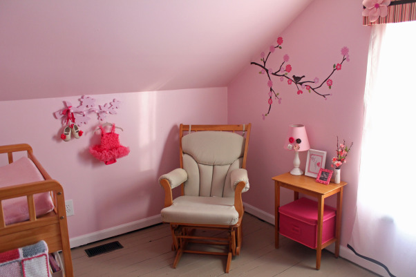 Cherry Blossom Nursery, After 14 years of boy themed rooms, we finally got to complete a pink girl's room! We chose a cherry blossom theme. Most of the room was DIY and inexpensive to finish. More details of the projects and room are at pinnedsisters.com, The glider corner , Nurseries Design