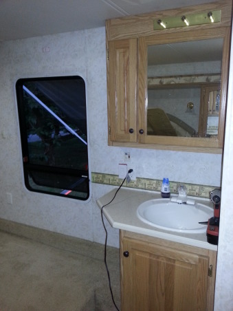 RV Renovation, Completely renovated our 2003 Carriage Carri-lite. Being full timers we wanted the space to feel like our home! So when we got time off and were out of the RV for a little while we spent around 3 months changing everything out!  Some of the photos don't show the completed shades on (I made the Roman Shades myself so they took some time!) We're still planning on changing carpets in main living area and putting in a smaller version (but still bigger than the biggest RV oven) residential gas oven and a tank less water heater!  , Before sink view     , Other Spaces Design