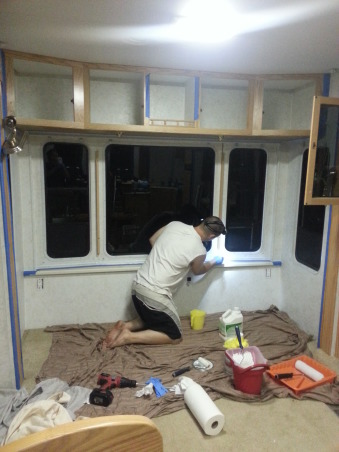 "RV Renovation, Completely renovated our 2003 Carriage Carri-lite. Being full timers we wanted the space to feel like our home! So when we got time off and were out of the RV for a little while we spent around 3 months changing everything out!  Some of the photos don't show the completed shades on (I made the Roman Shades myself so they took some time!) We're still planning on changing carpets in main living area and putting in a smaller version (but still bigger than the biggest RV oven) residential gas oven and a tank less water heater!  , Couldn't find a true ""before"" photo of this area, so I had to use one mid-reno        , Other Spaces Design"