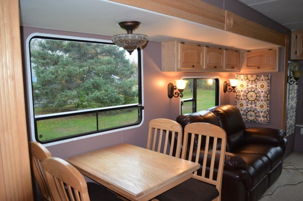 RV Renovation, Completely renovated our 2003 Carriage Carri-lite. Being full timers we wanted the space to feel like our home! So when we got time off and were out of the RV for a little while we spent around 3 months changing everything out!  Some of the photos don't show the completed shades on (I made the Roman Shades myself so they took some time!) We're still planning on changing carpets in main living area and putting in a smaller version (but still bigger than the biggest RV oven) residential gas oven and a tank less water heater!  , Before I had finished the curtains, but we had reupholstered chair cushions and changed every light fixture.     , Other Spaces Design