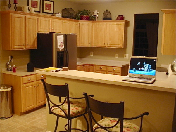 "Builder Bland Kitchen Gets A Custom Look, We recently gave our builder basic kitchen a budget friendly makeover.  Using paint and trim, we made our birch, stock grade cabinets look taller.  New appliances, flooring, counters and DIY wine storage cabinet gave our kitchen a custom look.  Stop by my blog for DIY project tutorials and more dramatic room makeovers: http://www.theyellowcapecod.com, The kitchen ""Before"". , Kitchens Design"