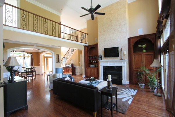 My great room, 2 story great room, catwalk with wrought iron railings, dining room, and front entry, Living Rooms Design