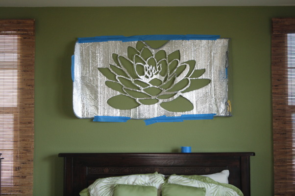 Dreamy Island Bedroom, Here's my finished master bedroom! It's got tropical influence with two shades of green, grounding wood furniture, and highlighted with cream curtains. I then decided to paint a lotus flower as a centerpiece. I used car sun reflector as my stencil, used an exacto blade to cut out the flower, then stenciled it on the wall. Took FOREVER but cost me nothing because I already had supplies and paint. I am most proud of the Lotus :) Bargain finds: bed spread Walmart, curtains Target, shades BB&B, Lowes Paint (I think we got Valspar Dune Grass & Everglade). Splurge finds: bedroom furniture Pier 1, & nara lamps Cost Plus World Market., This is the sun reflector I used to cut out the stencil.         , Bedrooms Design