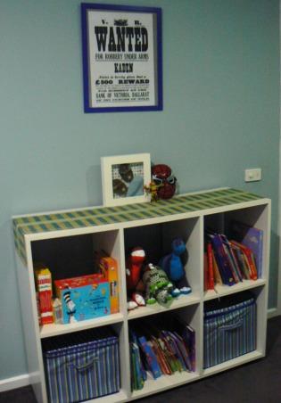Kadens room has been 'superheroed', Our 5 year old boys 'superhero' bedroom, with lots of superhero things., His bookshelf and toy storage , Boys' Rooms Design
