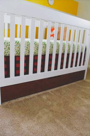 "Asher's Lumberjack Inspired Nursery , Since we are military and live in base housing, I wanted a room that was easy to pack up and move to our next home, and something that would also grow with my little guy. I was inspired by a Paul Bunyan book which you can see framed in the room. I wanted something vintage but yet modern at the same time.   Furniture: Crib- Walmart Dresser (changing table) - Ikea Malm Collection Bookshelf- Ikea  Rocking Chair- Ikea  Bedding: Crib Bedding- I made all the crib bedding other than the fox. The fabric I purchased off Etsy. Plush Fox- Gingiber Etsy Shop  Accessories: Plaid Throw- Gift Denim Pouf- Crate and Barrel Wood Base Lamp- Target Plaid Shade- Made by Me! Cardboard Bull- Ebay Woodgrain Hanging Lamp- Target Woven Blue Basket- The Land of Nod Wooden Owl Bookends- Thrifted Yellow Metal Crate- Thrifted  Paul Bunyan Book- Belonged to my Mom Frames- All of the frames in the room came from Target Shelf- Lowe's  Boy Scout's Uniform- It was Jacob's when he was a little boy Wooden Owl- Thrifted Metal ""A""- Urban Outfitters Fox and Letter Print Burp Cloths- Made by Me! Animal Print- The Land of Nod Timber Print- Gift from a very talented friend!  Green Owl Coin Bank- Urban Outfitters  Wooden Mushroom- TJ Maxx Moccasins- Minnetonka  Embroidery Hoop- Made by Me! (purchased material from a local fabric store) Crochet Marine Corps Hat- Knitting Nannies Picture Book- Gift from Asher's newborn photographer Wooden Missouri Teether- Little Sapling Toys Etsy Shop Owl Baby Book- Ruche  Changing Station: Changing Pad Cover- Sweetheart n Sunshine Etsy Shop Humidifier- Crane Clear Tray- Target, Nurseries   Design"