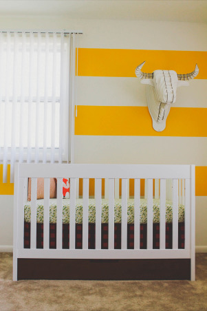 "Asher's Lumberjack Inspired Nursery , Since we are military and live in base housing, I wanted a room that was easy to pack up and move to our next home, and something that would also grow with my little guy. I was inspired by a Paul Bunyan book which you can see framed in the room. I wanted something vintage but yet modern at the same time.   Furniture: Crib- Walmart Dresser (changing table) - Ikea Malm Collection Bookshelf- Ikea  Rocking Chair- Ikea  Bedding: Crib Bedding- I made all the crib bedding other than the fox. The fabric I purchased off Etsy. Plush Fox- Gingiber Etsy Shop  Accessories: Plaid Throw- Gift Denim Pouf- Crate and Barrel Wood Base Lamp- Target Plaid Shade- Made by Me! Cardboard Bull- Ebay Woodgrain Hanging Lamp- Target Woven Blue Basket- The Land of Nod Wooden Owl Bookends- Thrifted Yellow Metal Crate- Thrifted  Paul Bunyan Book- Belonged to my Mom Frames- All of the frames in the room came from Target Shelf- Lowe's  Boy Scout's Uniform- It was Jacob's when he was a little boy Wooden Owl- Thrifted Metal ""A""- Urban Outfitters Fox and Letter Print Burp Cloths- Made by Me! Animal Print- The Land of Nod Timber Print- Gift from a very talented friend!  Green Owl Coin Bank- Urban Outfitters  Wooden Mushroom- TJ Maxx Moccasins- Minnetonka  Embroidery Hoop- Made by Me! (purchased material from a local fabric store) Crochet Marine Corps Hat- Knitting Nannies Picture Book- Gift from Asher's newborn photographer Wooden Missouri Teether- Little Sapling Toys Etsy Shop Owl Baby Book- Ruche  Changing Station: Changing Pad Cover- Sweetheart n Sunshine Etsy Shop Humidifier- Crane Clear Tray- Target, Painted Yellow Wall Stripes: Sherwin Williams Citrus   , Nurseries   Design"