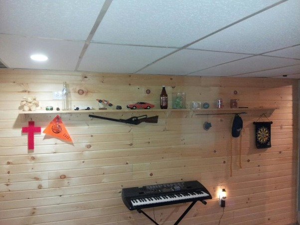 Son's Hunting Theme bedroom, Basement bedroom for a 15 year old boy.  Had a moisture issue, so after ripping out the walls to the bare block, I added a walk-in closet, tile landing (not finished yet) pine siding, and my wife put her artistic talents to work., homemade shelves  , Bedrooms Design
