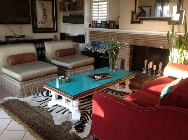 Before and After Green Red Blue Yellow Small Living Room, This is a Before and after redo. Our home is a combination of Pier One and other thrift and vintage finds.  It is a work in progress, as the barrel chairs were purchased from an estate sale and need serious refinishing. I plan to put a red drum light above the I'd Inge room table and add candles to our fireplace along with mirrors. Looking forward to your thoughts and ideas. We just got married and are renting and very limited to making structural changes to the home. , This coffee table was purchased for $25 and refinished in a beautiful turquoise blue which is my favorite color is family-friendly and still beautiful enough to make the room elegant.     , Living Rooms Design