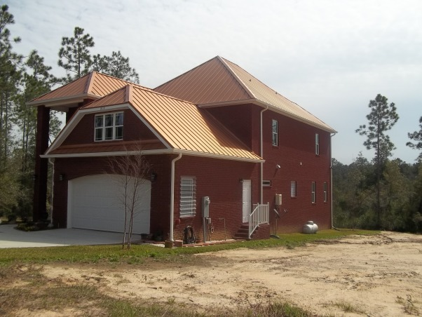 Copper Roof, Brand new All brick exterior with standing seam copper roof.  This European custom home is Functional, energy efficient  and Beautiful. The wrap around decks allow peaceful views of the nature preserve.  Inside you will find gorgeous 10 foot ceilings, handscraped hardwood on both floors(no carpet) 4 bedrooms, 4 baths, 2 masters, one each level with Spa bathrooms, large soaking tubs, tile walk in showers.  Upstairs a large  Loft area and bonus room. A second master suite with Spa bath guest suite with ensuite bath and lovely views from every window. Water closets located in each bathroom with esquisite chandeliers  The patio size lot keeps upkeep easy, West side of house over looks nature preserve and bridge   , Home Exterior Design